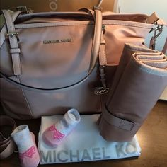 "DIAPER BABY BAG Blush Michael Kors NWT! Gorgeous 100% Authentic diaper bag. Blush color combined with silver hardware.  Comes with changing pad. Paper work and tags are attached.  Perfect new condition.  Long strap is adjustable and detachable as well.  Measurements: L16.5""/ H11.5"" Handles: 10"" Drop Strap: 14""/22""  Material Pale Pink/Blush color  Retail price: $298 Michael Kors Bags Shoulder Bags"