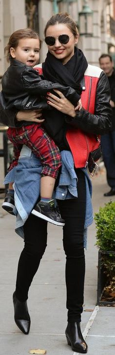 Who made  Miranda Kerr's black skinny jeans, black scarf, red leather belted jacket, gold jewelry, and denim long sleeve top that she wore i...
