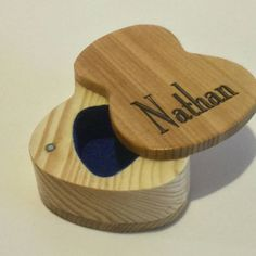 Custom engraved Wooden Hand Made Guitar Pick Box - Inspired from the shape of an acoustic guitar - Cedar & Pine  All guitar players need a special place to keep their prized picks or maybe you know a guitar player that would like a treasure/ jewelry box. This wooden box is the perfect!! Add the music lovers name to make it extra special. The box is approximately 2 3/4 deep X 2 wide X 7/8 tall. The inside of the box is shaped like a guitar pick, just the right size to hold s...