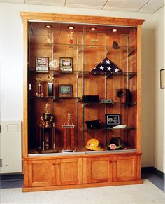 Trophy Case in the man cave for all my sports/motorcycle trophies