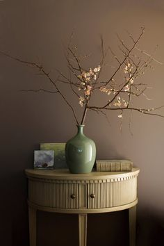 Brown tones give this dusky paint color and entry area a period-perfect air.   Weimaraner AF-155, Aura, Matte, @benjamin_moore