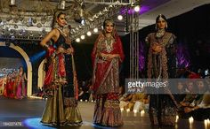 Models present creations by designer Sahar Atif during the Pakistan Fashion Design Council Bridal Week in Lahore on October 12 2013 AFP PHOTO / ARIF...