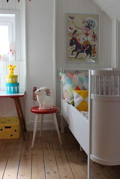 Gorgeously simple toddler or preschooler bedroom with lots of white... including a cute white rabbit night light.