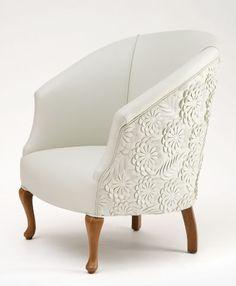 Dainty, clean, white tub chair.