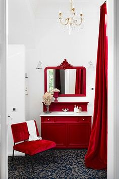 Bathroom with Red Decor. What a great way to put some major drama in your house.