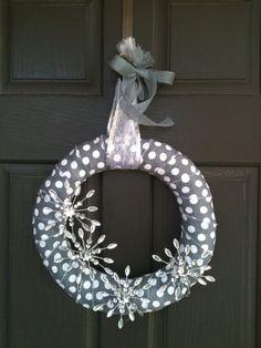 Winter ploka dot snowflake wreath reminds me...I want to make a snowflake wreath of some kind.  Need January door decor.