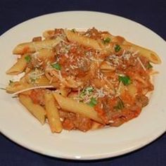 Hearty Italian sausages sauteed with garlic and red pepper flakes are simmered with tomatoes and cooked with vodka and cream to make a rich, spicy sauce. Toss with penne and fresh parsley to serve.