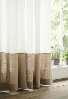 Close-up of a curtain that has been extended with a beige fabric at the bottom