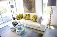 Sam Allen Interiors- LOVE the acrylic coffee table with moroccan poufs