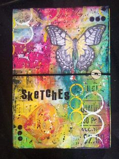Altered fabric sketchbook cover with @paperartsy paints.