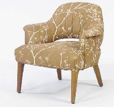 A BROWN AND WHITE UPHOLSTERED BERGERE,