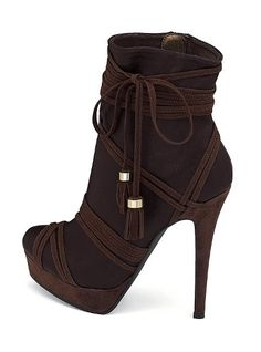 Again, not a bootie person, but the curves, the shape of the tip of the shoe and the heel along with the intricate lines makes it oh so sexy!