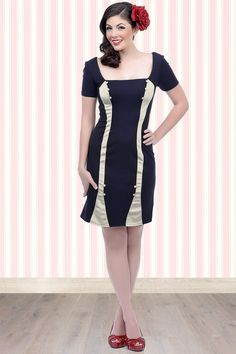 """This50s Mamie Two Tone Wiggle Dress in Navy & Ivoryby Unique Vintage is truly to die for!  Fitted wiggle style, made from a slightly stretchy supple navy blue jersey knit for a gorgeous curve hugging fit, oh la la!Sensible short sleeves meet a subtle square neckline dotted withdarling fabric covered buttons. Hits above the knee with a length of 1.73m / 5'7"""" and finished off with a hidden zipper at the back. With vertical ivory detailing on the front and back for a ..."""