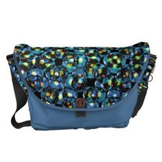 """Blue Bubbles messenger bag by Valxart.com $141.70  messenger bag by Valxart.com messenger bag by Valxart.com $141.70 Water resistant, extra durable (machine-washable). Large main compartment and 2 front pockets. Form fitted to your body. Quick-adjust cam shoulder strap. Holds a 15"""" laptop (w/optional sleeve). Made with a sustainability focus in San Francisco, CA. Dimensions 12"""" H x 21"""" W x 9"""" D."""