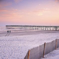 Secluded Southern Beach Vacations: Sunset Beach and Bird Island, NC. A half-hour drive from Myrtle Beach's high rises brings you to a little beach town full of rambling rental houses. Sunset Beach proudly preserves its undeveloped beachfront with wide set