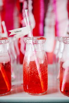 Shirley Temple's in cute milk jars with paper straws-- the best addition to any Valentine's Party!!