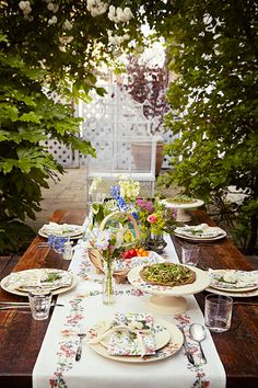 An al fresco table setting in the Liberty way.  Browse tableware from the Flowers of Liberty collection: www.liberty.co.uk/flowersofliberty