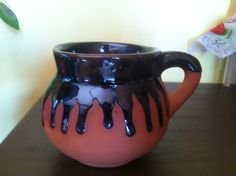Handmade Mexican Coffee Cup Clay Mug With Drip Glaze Mexico Spanish. $5.99, via Etsy.