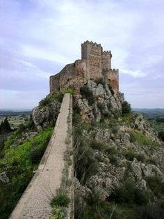 CASTLES OF SPAIN - Castle of Alburquerque - Luna. (Badajoz). Looming large above little Alburquerque is the intact Castillo de Luna. The centrepiece of a complex frontier defence system of forts, the castle was built on the site of its Muslim predecessor in the 13th century and subsequently expanded. From the top of the five-sided 15th-century defensive tower, views take in the Portuguese border (the Portuguese actually took the town for a few years in the early 18th century)