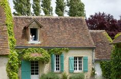 I adore this cottage! Love the reader perched in the window upstairs too!