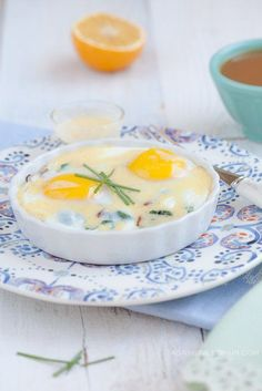 Baked Eggs with Bacon and Power Greens with Paleo Hollandaise Sauce - Danielle Walker's Against All Grain