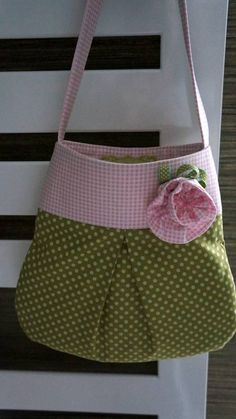 Cute pleated bag embellished with a flower