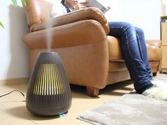 """This ultrasonic """"mood"""" humidifier has an aroma diffuser capability and can emit a soft glowing light while the unit is working. The water vapor, scent, and light all work to calm your senses."""