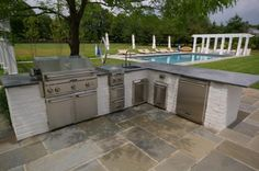 Mesmerizing Pool Outdoor Kitchen Pics with Soapstone Countertops Outdoor Kitchen and Brushed Nickel Kitchen Sink Faucet on Slab Stone Paving