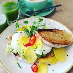 Guaranteed to get you out of bed on a Wednesday morning. Avocado on sourdough toast with poached eggs, candied beetroot and fresh chilli. #rudehealthcafe  @eatyourcolourschallenge