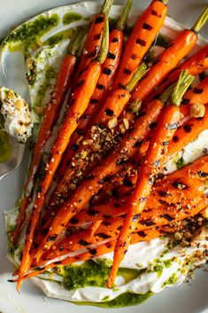 Grilled Carrots With Yogurt, Carrot-Top Oil and Dukkah Recipe - NYT Cooking Grilled Carrots, Grilled Meat, Vegetable Side Dishes, Vegetable Recipes, Vegetarian Recipes, Dukkah Recipe, Carrot Top, Vegan Dishes, Carrot Dishes