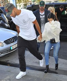Protective: Younes held on tightly to Kourtney's hand as they walked along