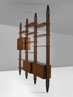 Franco Albini Modular Bookcase for Poggi in Rosewood | From a unique collection of antique and modern bookcases at https://www.1stdibs.com/furniture/storage-case-pieces/bookcases/