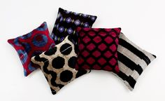 Madeline Weinrib Velvet Ikat Pillows. Each pillow has been hand sewn in New York and finished with stitched suede piping, Belgian linen backing, goose down filler and mother-of-pearl buttons.