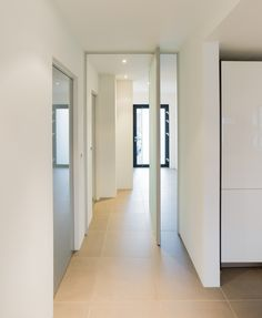 The floating appearance of this pivot door makes this hallaway or annex pop! Check out our own hand crafted pivot doors at http://pivotdoorcompany.com/