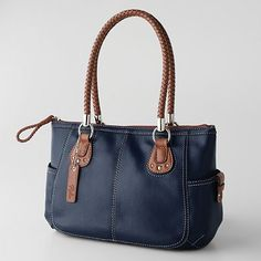 The color, the shape, the size, the weight... this is an appealing bag!