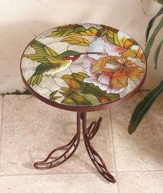 Stained Glass Accent Table looks beautiful holding a potted plant or as a decorative piece on your patio. These lovely tables have garden-themed, stained glass tops on decorative metal bases. Stained Glass Projects, Stained Glass Patterns, Stained Glass Art, Mosaic Glass, Fused Glass, Mosaic Furniture, Plywood Furniture, Mosaic Outdoor Table, Mosaic Garden Art
