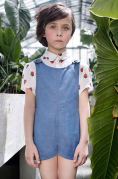 Strawberry blouse and chic blue overall. quenotte. #designer #kids #fashion
