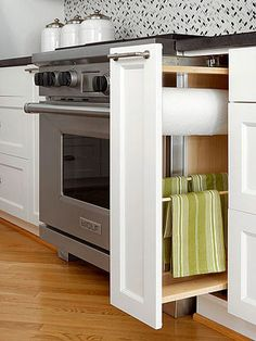 Kitchen Cabinet Option - this is a great option to keep in mind when planning a remodel. A narrow pull-out cabinet near the sink, holds paper and dish towels.