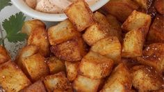 Patatas Bravas is a classic Spanish dish of fried potato cubes served with a spicy dipping sauce. Serve them up as a crowd-pleasing appetizer or side dish.