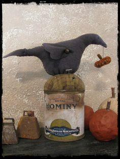 primitivebettys great crow pinkeep in an old hominy can. This would be cute on a mason jar - you could keep pins & other sewing supplies in the jar.  Gonna have to figure out how to make that work!