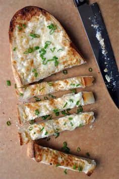 A simple secret ingredient makes for the best-ever cheesy garlic bread topped with sliced scallions.