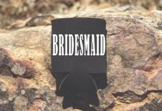Congratulations on your engagement. Our Bridesmaid can coolers will make a great gift for your bridal party for celebrating your special day. Also, perfect to add in your bridesmaid proposal box.  What's Included:  -Black Foam Can Coolers(4x4 inch) -Single-Sided Text -Text: Choose between White,