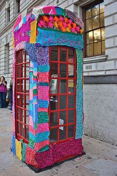 yarn bombed phonebooth