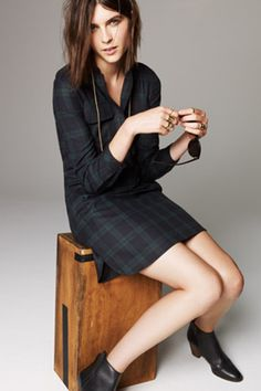 Plaid equals festive, sophisticated, and smart — ideal if you'll be chatting with a bunch of intellectuals until midnight.  Madewell Dark Plaid Blazer, $198, available at Madewell.