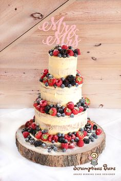 Semi Naked Buttercream Wedding Cake with Summer Berries, Mr & Mrs topper and wooden trunk cake stand