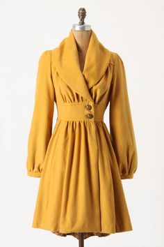 "Love the waist, sleeves and color of this marigold coat. A little more ""avant garde"" than my normal style."