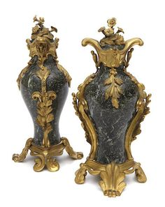 A pair of Louis XV style gilt bronze mounted variegated green marble urns fourth quarter 19th century