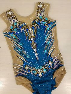 Leotard is sewed from biflex Italy, stretch mesh Italy , 3000 rhinestones DMC, 40 sewn rhinestones Asfur Egypt . This leotard can be stitched in any size. The cost of a leotard depends on the size of the girl and the amount of rhinestones.