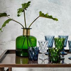 Stunning dark green glass vase with a decorative brass ring