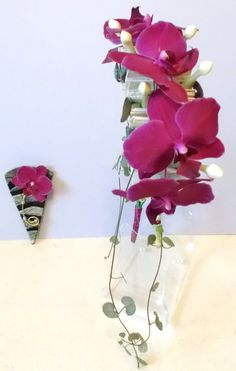 Side view of Orchid and Stephanotis flowers on a hand made fan.